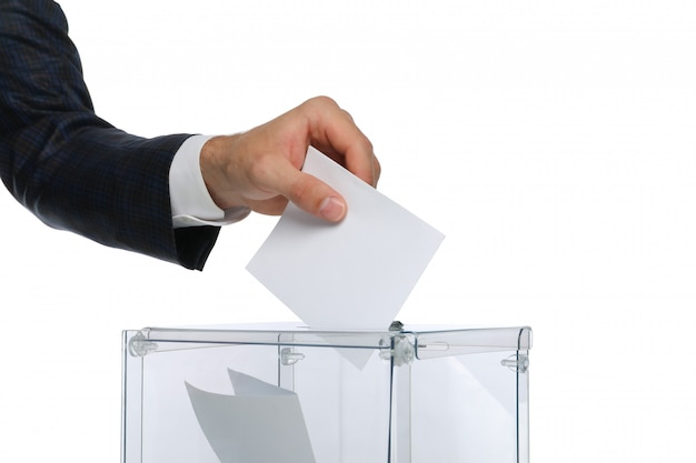 Man putting ballot into voting box isolated