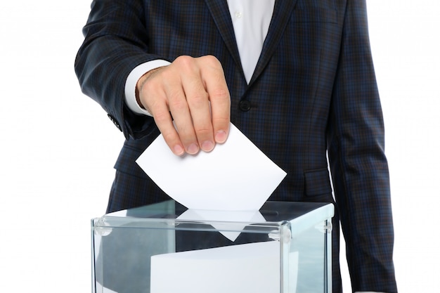 Man putting ballot into voting box