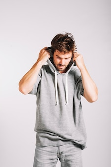 Man putting hood on