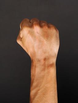Man raised fist on a dark, power, protester.