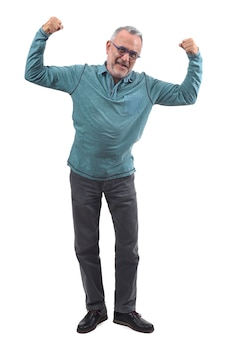Man raising her arms and smiling in victory sign on white