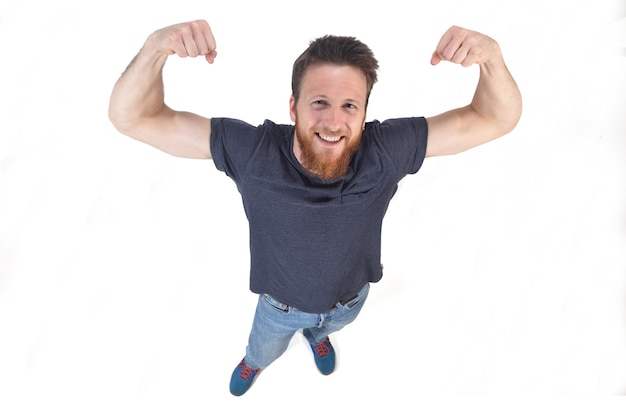 Man raising his arms making biceps and sign of victory and strengt