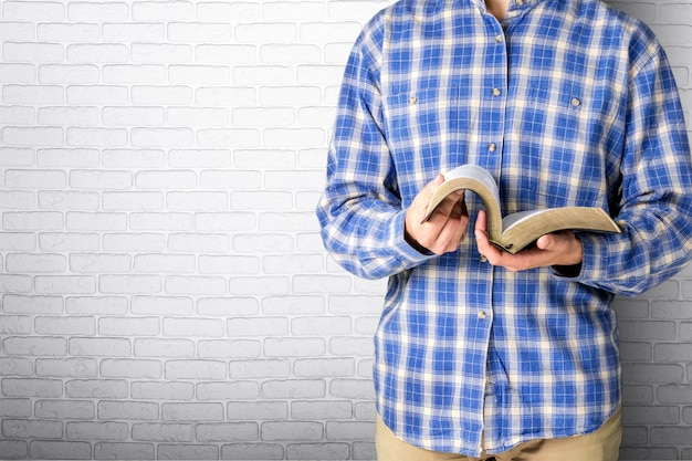 Man reading bible on  background