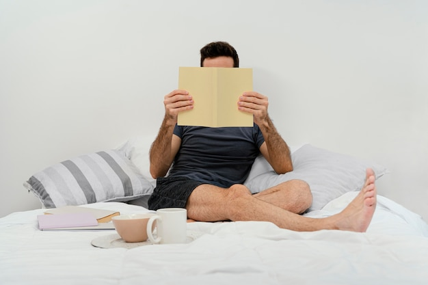 Man reading a book alone