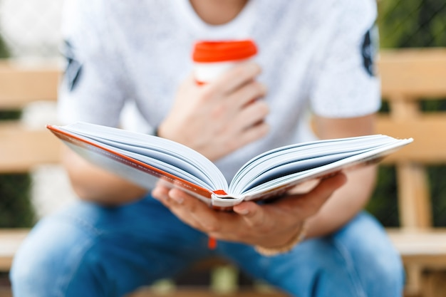 Man reading a book and drinking coffee