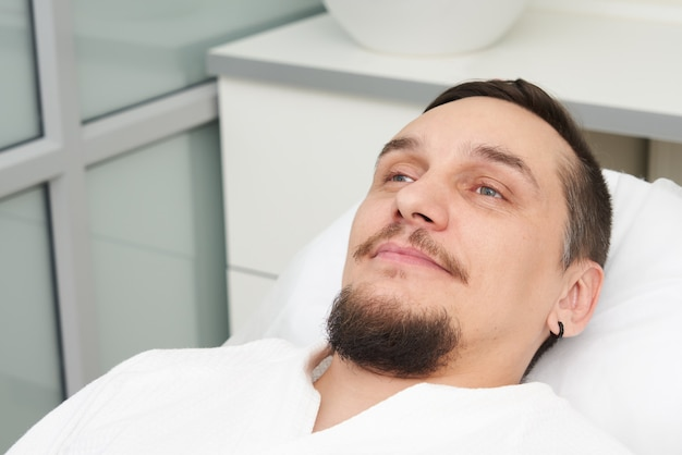 Man readyto to have treatment at beauty clinic