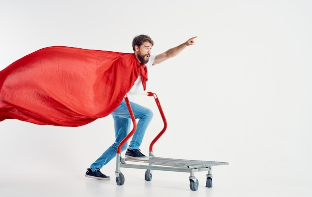 Man in a red coat jeans t-shirt cargo trolley light