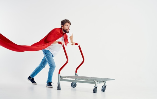 Man in a red raincoat jeans t-shirt cargo trolley light