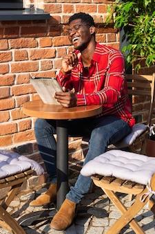 Man in red shirt laughing