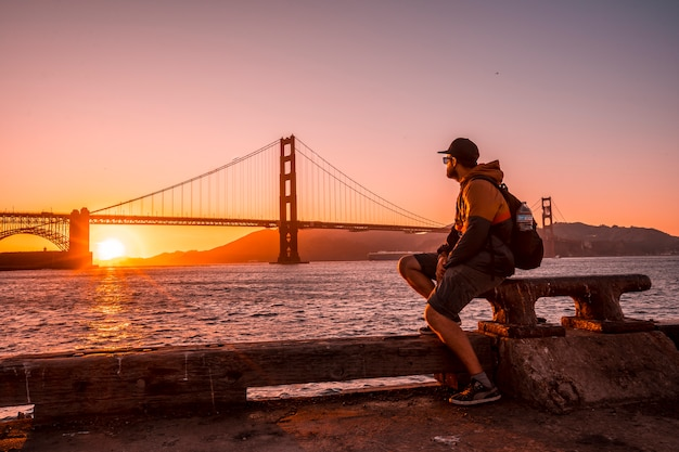 A man at the red sunset in the golden gate of san francisco. united states