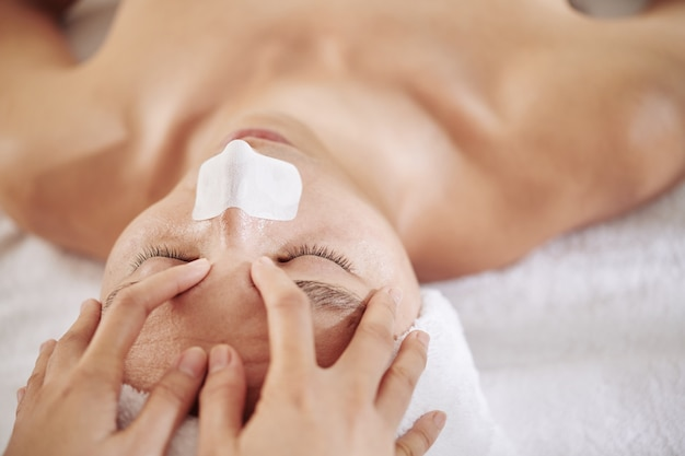 Man refreshing face massage