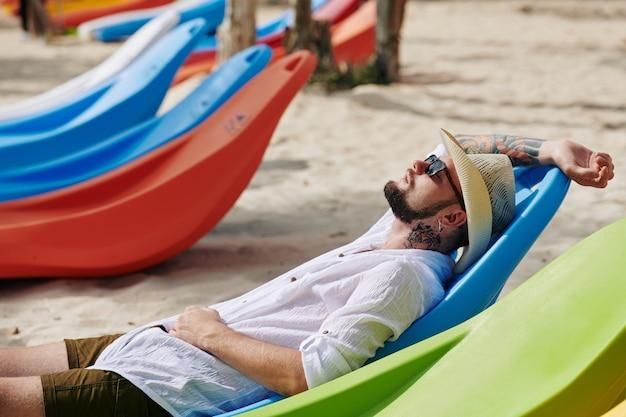 Man relaxing on beach Premium Photo