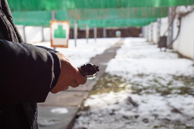 A man reloads a gun. winter, out of the door, shooting range