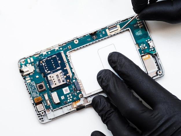 Man removing phone's components