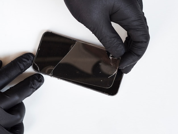 Man replacing a shattered phone screen