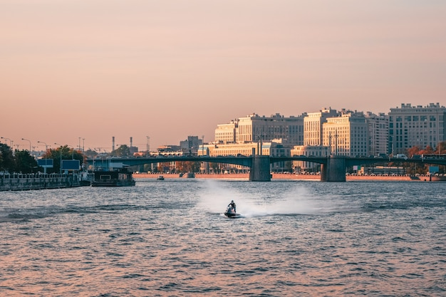 Man rides a jet ski on the neva river in the center of st. petersburg. russia.