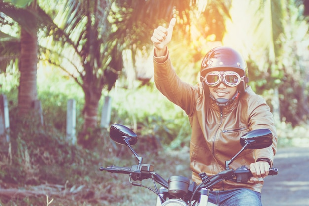 Man riding motorbike on a road in freedom lifestyle at vacation time