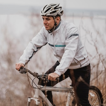 Man riding a mountain bike in special equipment