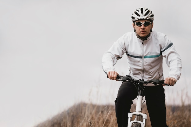 Man riding a mountain bike with copy space