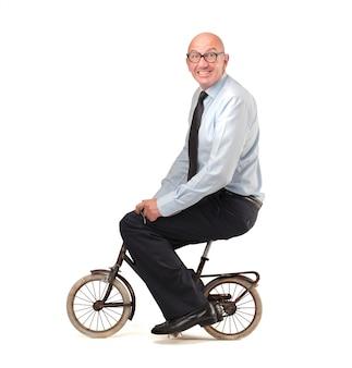 Man riding a tiny bike