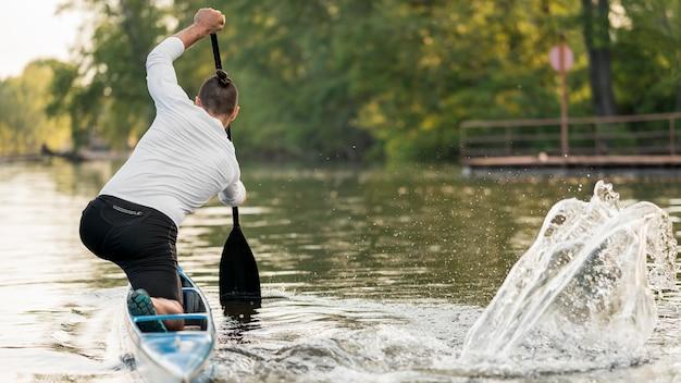 Man rowing full shot