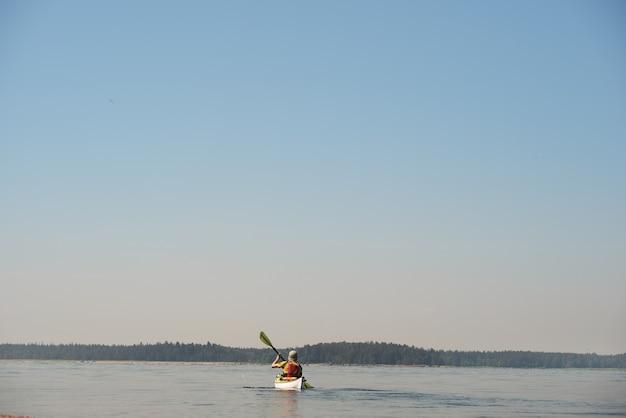 A man rowing a kayak. water sports theme