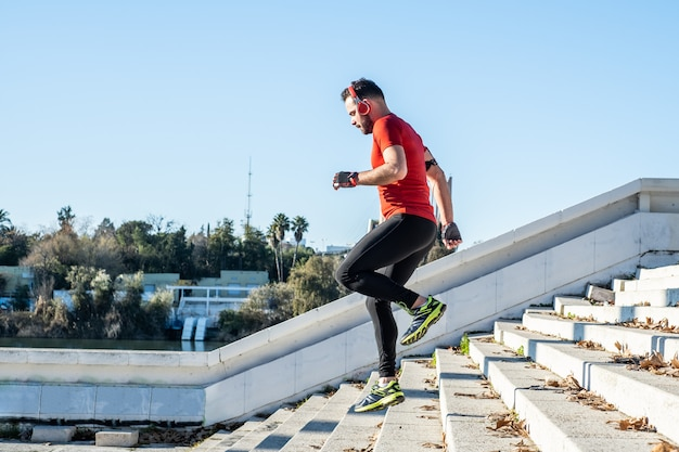 Man running down a flight of stairs and listening to music