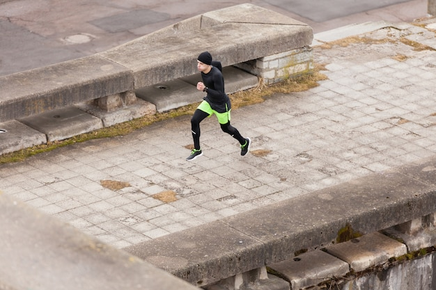 Man running in rainy city