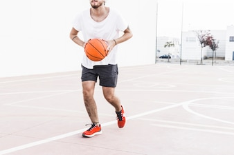 Man running with basketball