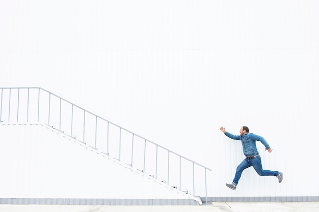 A man runs up the stairs