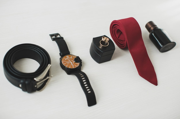 Man's accessories on a white table