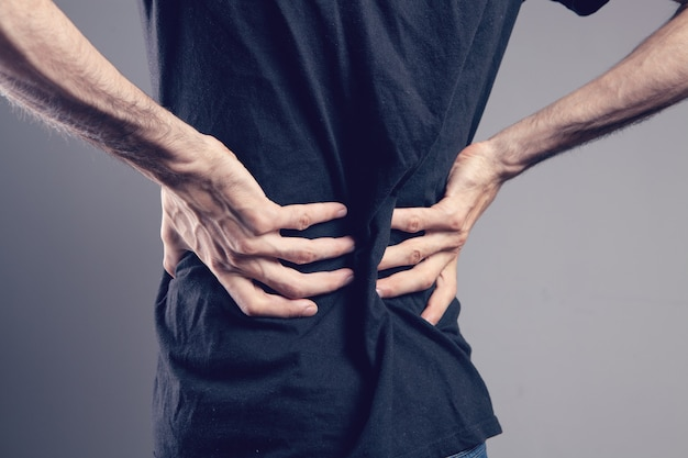 The man's back hurts. kidney pain