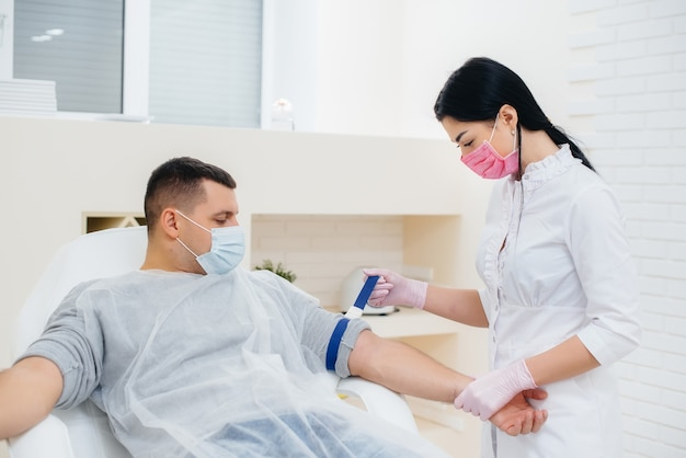 A man's blood is taken from a vein for analysis and testing for viruses. the formation of the immune system and antibodies.
