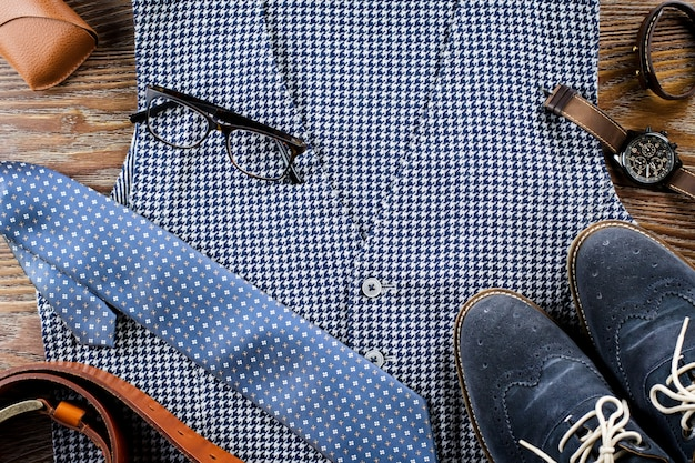 Man's classic clothes outfit flat lay with vest, tie, shoes and accessories.