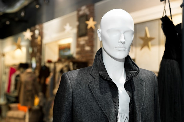 Man's coat on mannequin. autumn coat. individual tailoring