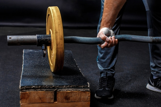 A man's fist, holding gymnastic barbell
