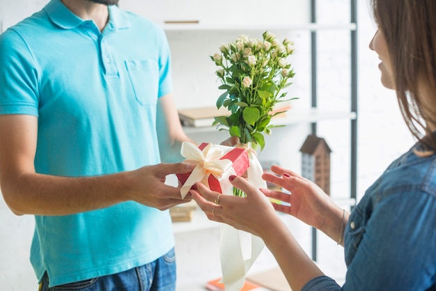 Man's hand giving present to his wife