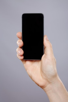 남자의 손을 잡고 휴대 전화 벽, 가까이, 비즈니스 개념, 모의.