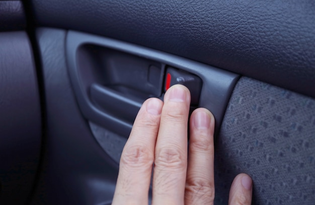 Man's hand at the modern car's inner handle