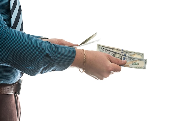 Man's hand in suit giving us dollar isolated on white wall. close up.