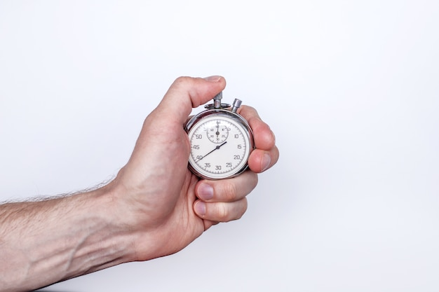 A man's hand with a stopwatch on a white background