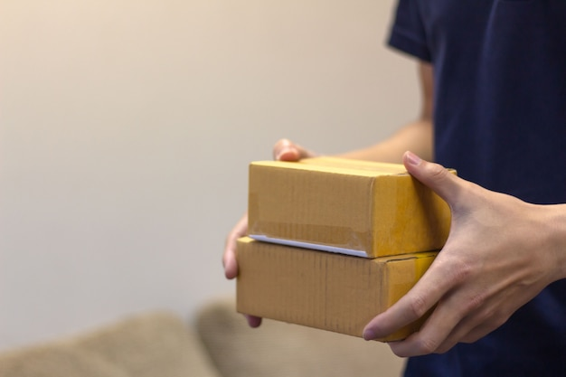 Man's hands holding the  carton box