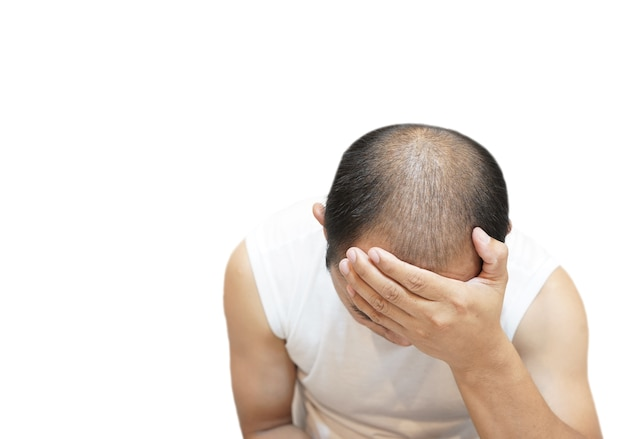 Man sad about hair loss problem on white background.
