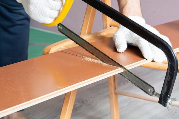 Man sawing laminate. laminate installation process