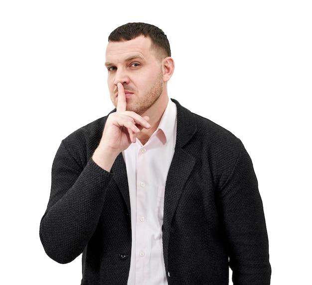 静かに言って、唇のジェスチャーで指で静かにする男