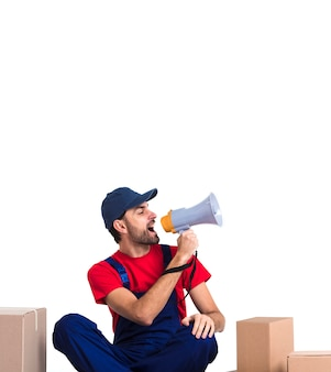 Man screaming in megaphone and holding a box copy space