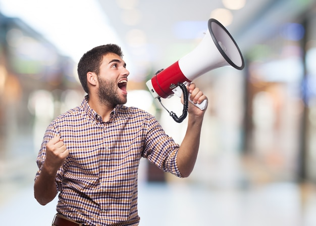 Man screaming in the megaphone