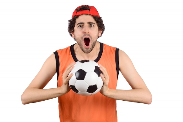 Man screaming with soccer ball.