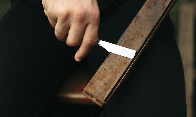 Man sharpening a blade