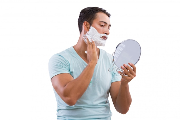 Man shaving isolated on the white background